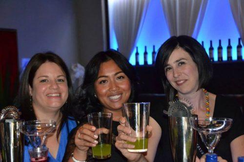 Women enjoying drinks from cocktail making class