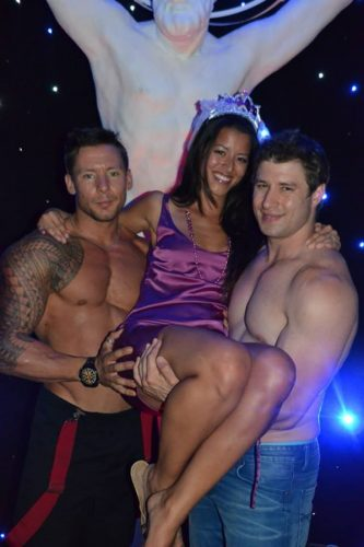 Hen posing with two male strippers